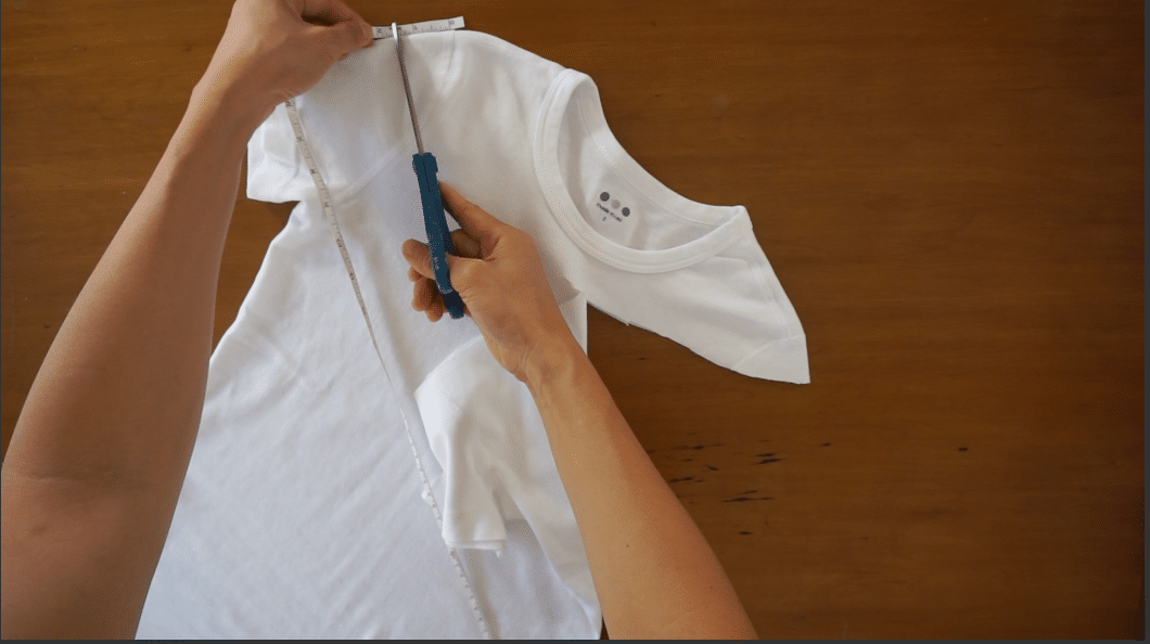 Draw a line from shoulder to shoulder with fabric chalk, and then cut along the line with scissors to create a new neckline.