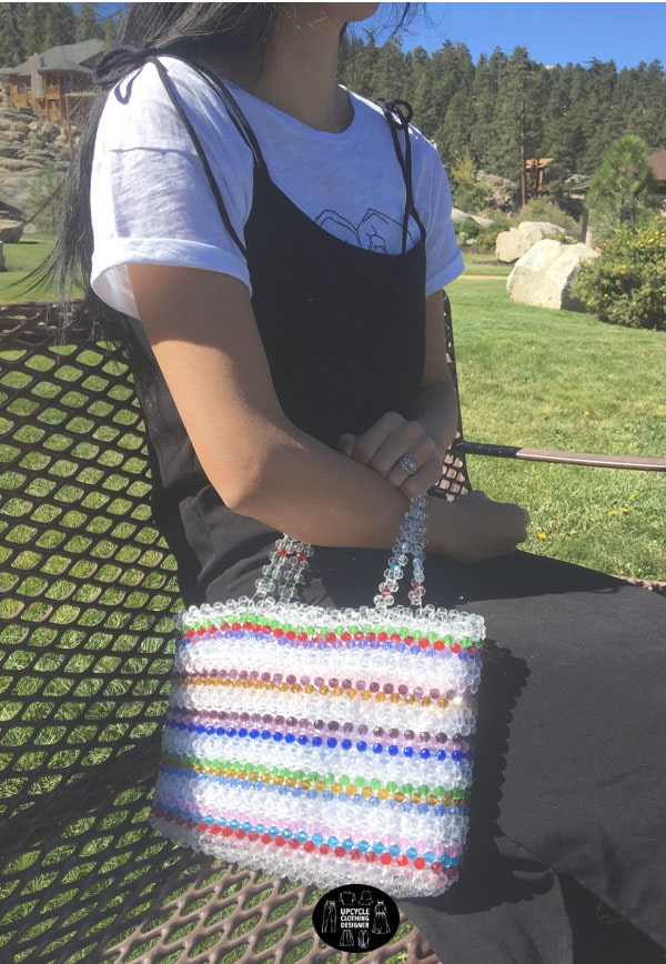 Beaded purse with a colorful stripe pattern.