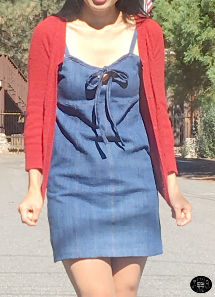 Wearing a denim mini dress from old jeans with a red cardigan on top.