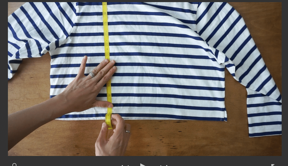 measure down the front of the knit top from the high point on the shoulder.