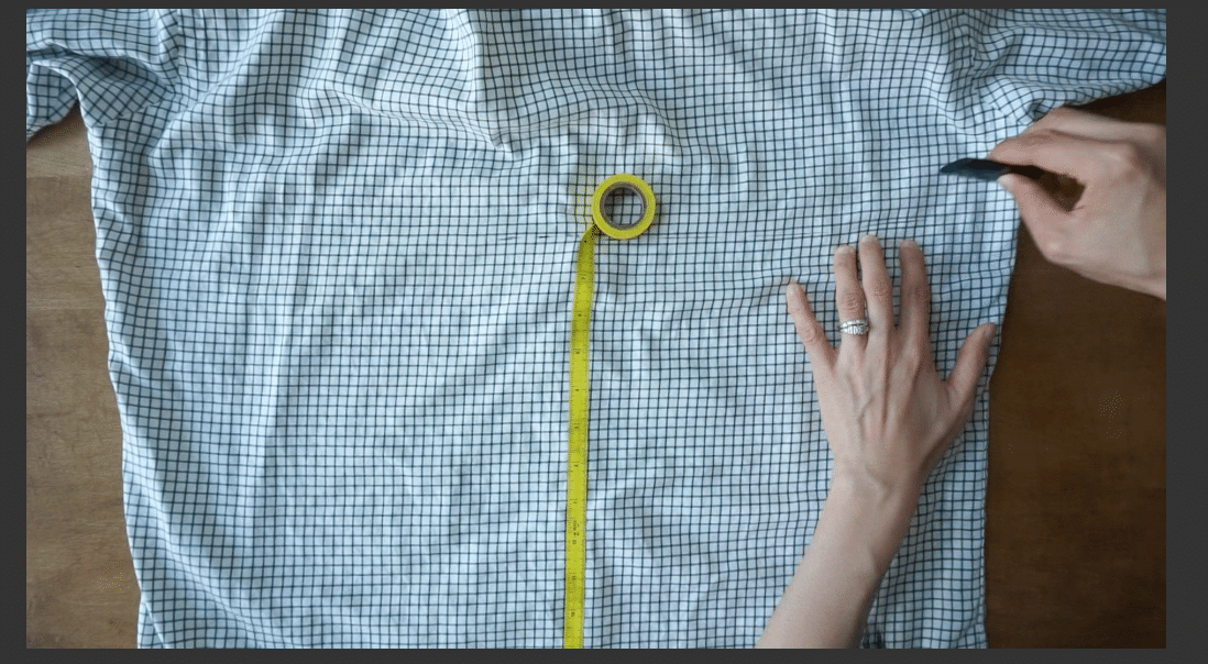Measure and cut the back piece of the woven shirt.