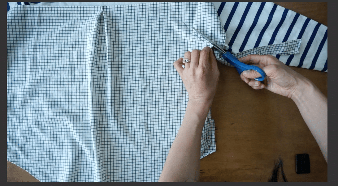 Cut the excess woven shirt fabric.