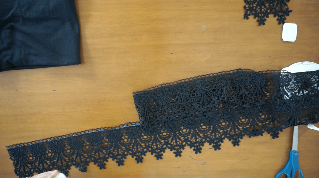 Glue the layers of lace trim to secure them in place