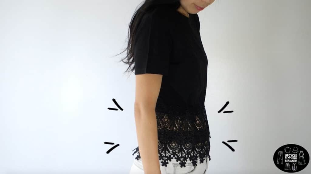 Demonstrating the ability of the lace peplum to hide the tummy. Emphasis is placed on the waistline of the peplum top.