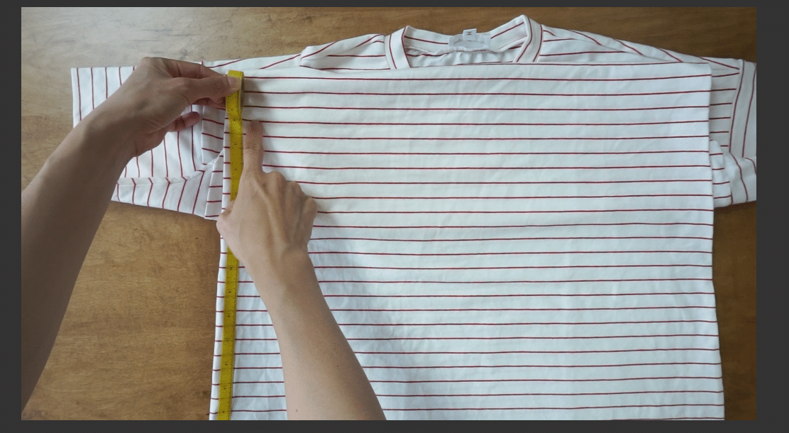Measure up from the bottom hemline of the top.
