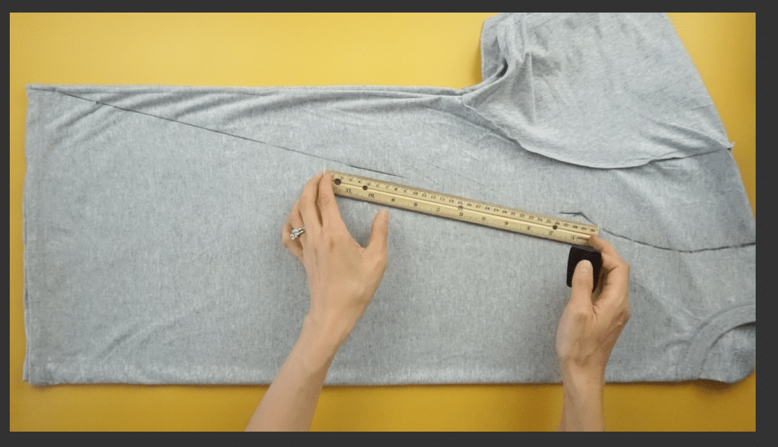 Measure and mark the A-line silhouette for the dress using fabric chalk.