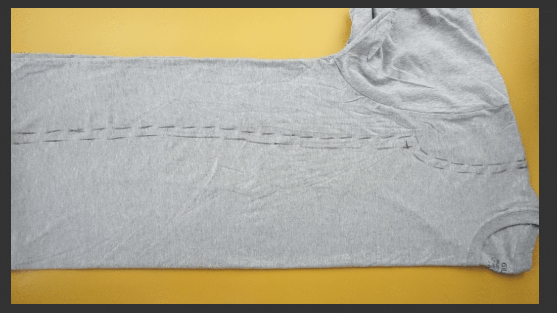 Measure and mark the dress silhouette on the t-shirt using fabric chalk