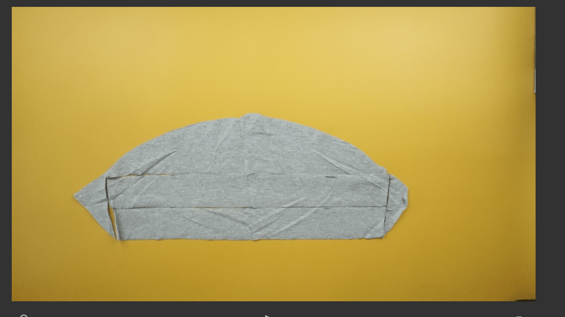 Use excess fabric to hem around the armhole.