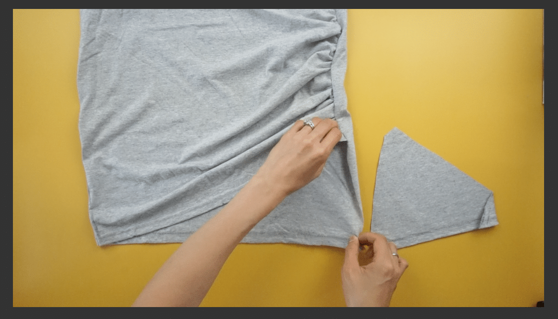 Attach the panel to the bottom hem of the t-shirt dress in order to cover the upper thigh.