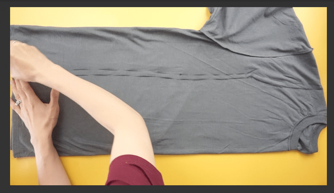 Measure and mark the dress silhouette on the t-shirt with fabric chalk.