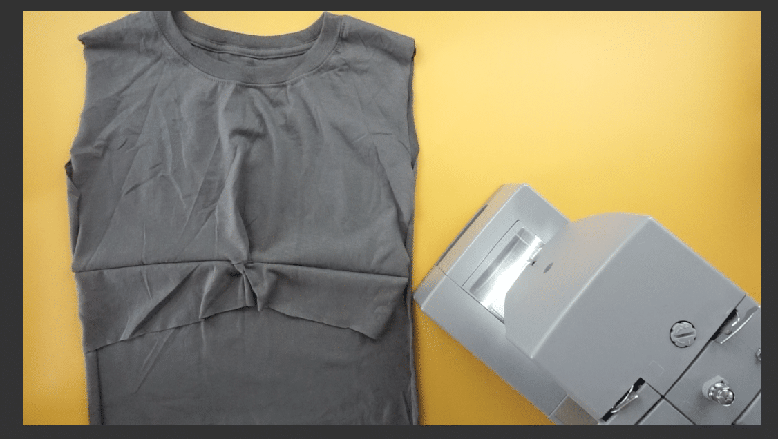 Trim the bottom of the front twist to give more shape to the t-shirt dress.