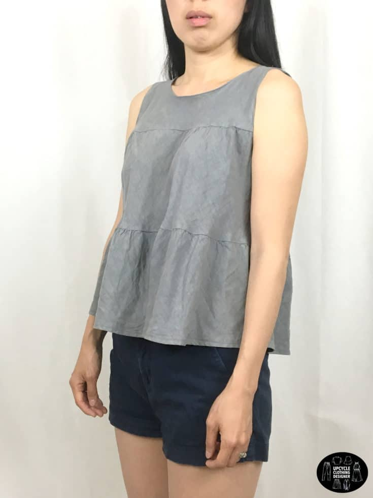 Sideview of sleeveless top from upcycle skirt