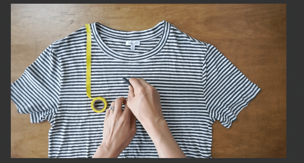 Measure down from the high point on the shoulder to mark the new V-neckline
