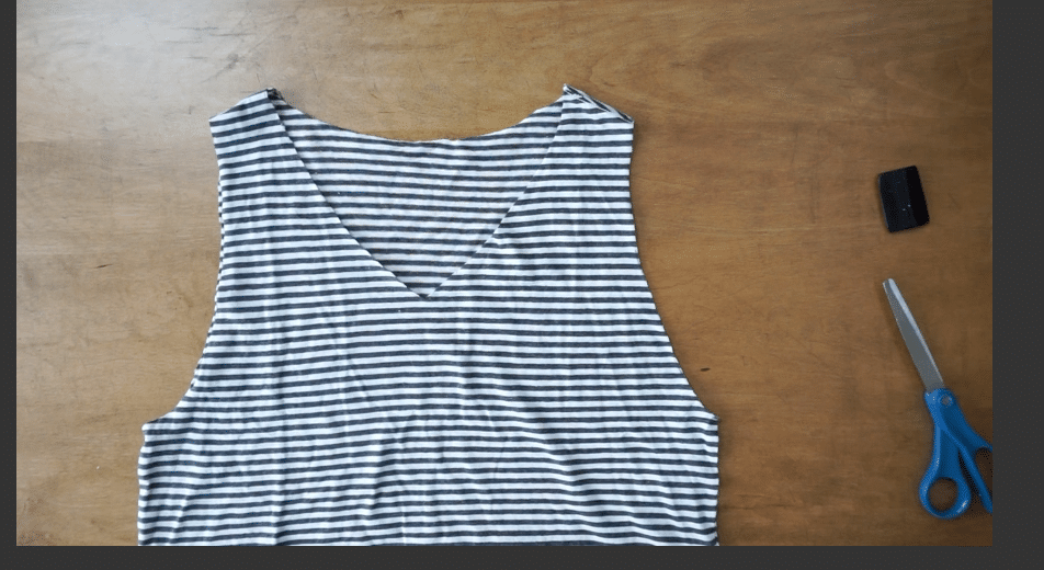Cut along the arm opening to remove the sleeve and make the tank top