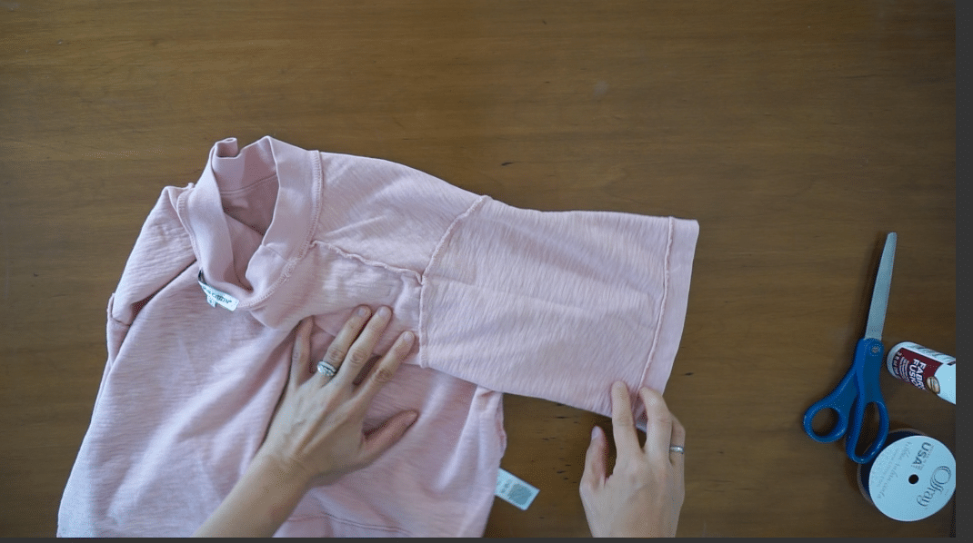 Flip the shirt inside out and lay the sleeve flay.