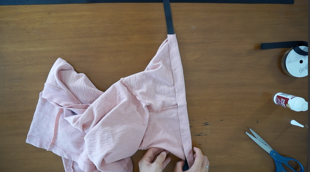Fold the arm opening over the grosgrain and secure with fabric glue.