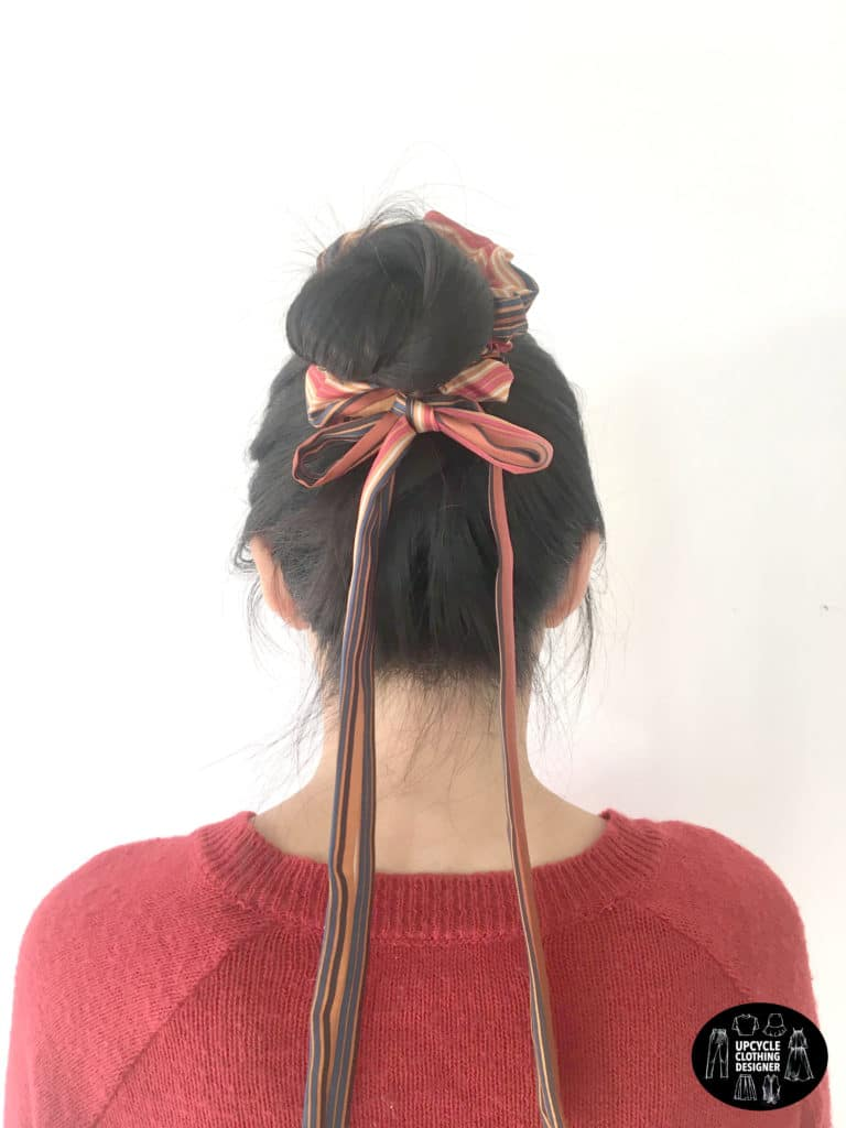 DIY no sew hair bow scrunchie in a topknot hairstyle