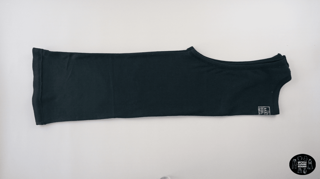 Fold tank top in half lengthwise