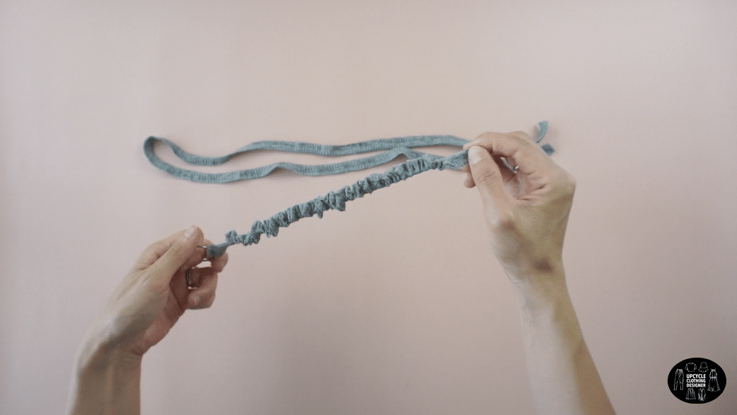 Flip the drawstrings inside out using a loop turner