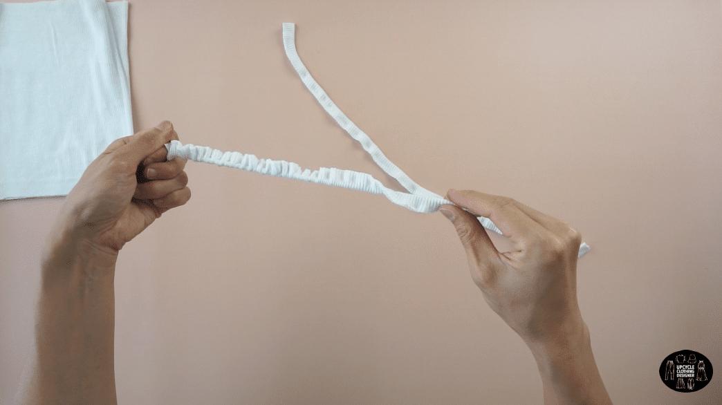 Use a loop turner to flip the shoulder straps inside out