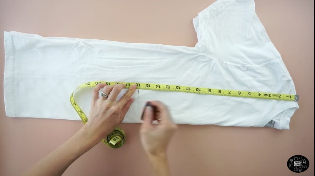 """Fold the t-shirt in half lengthwise. Mark 16"""" down from the shoulder seam."""