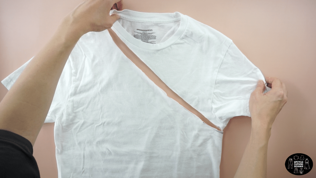 Draw a line connecting both points and cut to make an asymmetrical neckline.