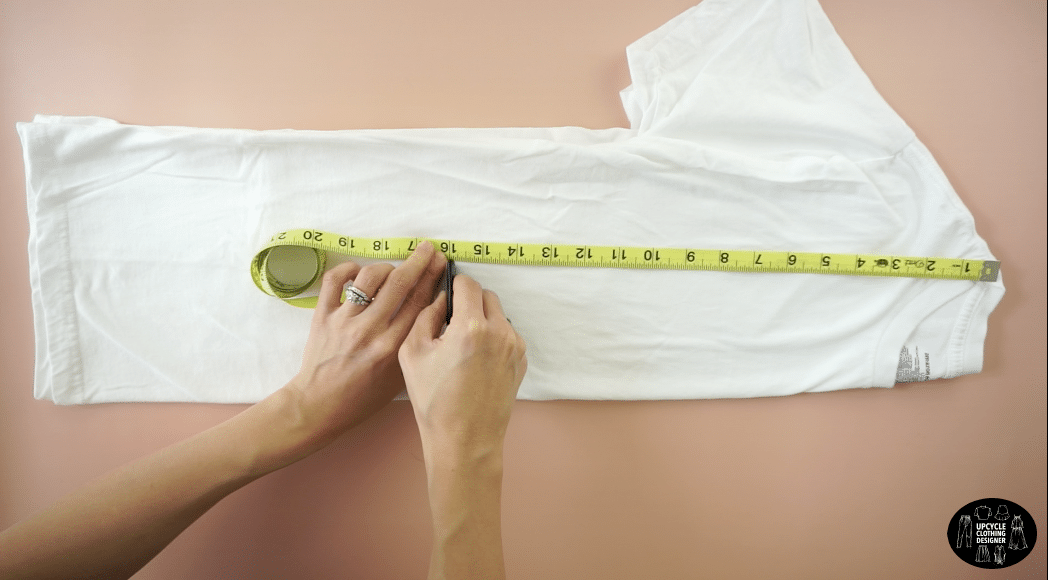 """Fold the t-shirt in half lengthwise and mark 16"""" down from the high point on the shoulder."""