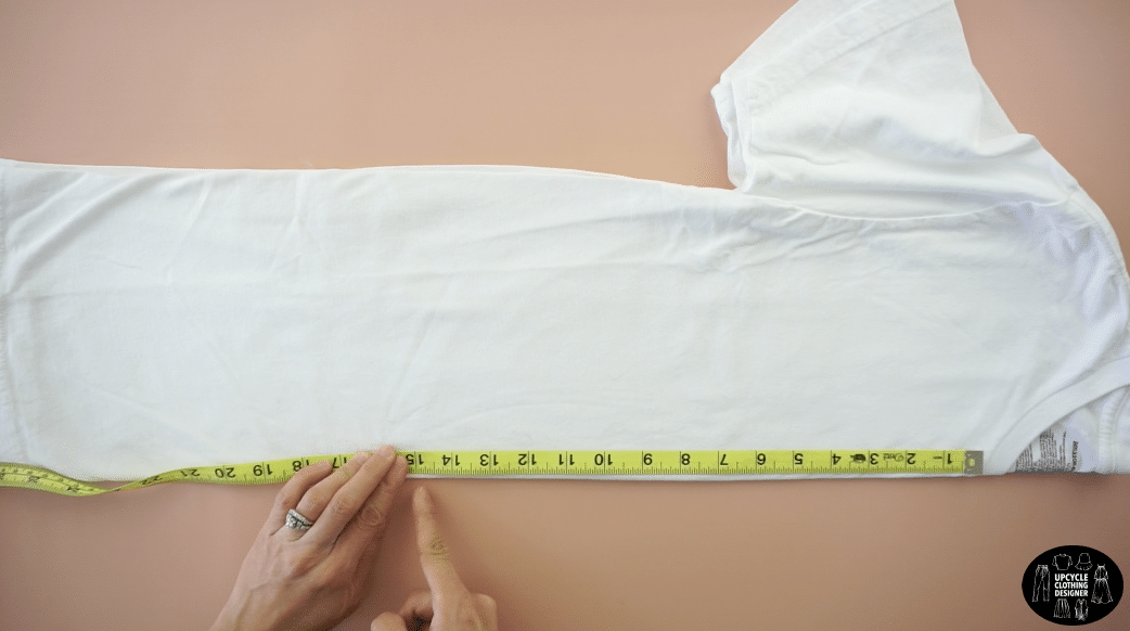 "Fold t-shirt in half lengthwise and mark 15"" down from the high point on the shoulder."