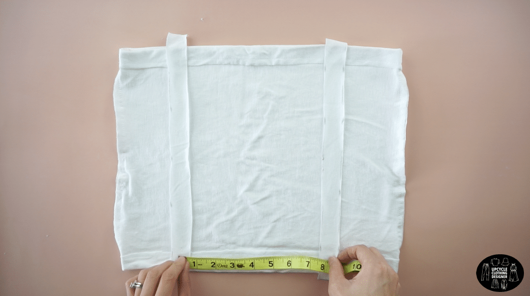 """Line up the ruched panels vertically on the front and back of the crop top. Space 8"""" apart from each other."""
