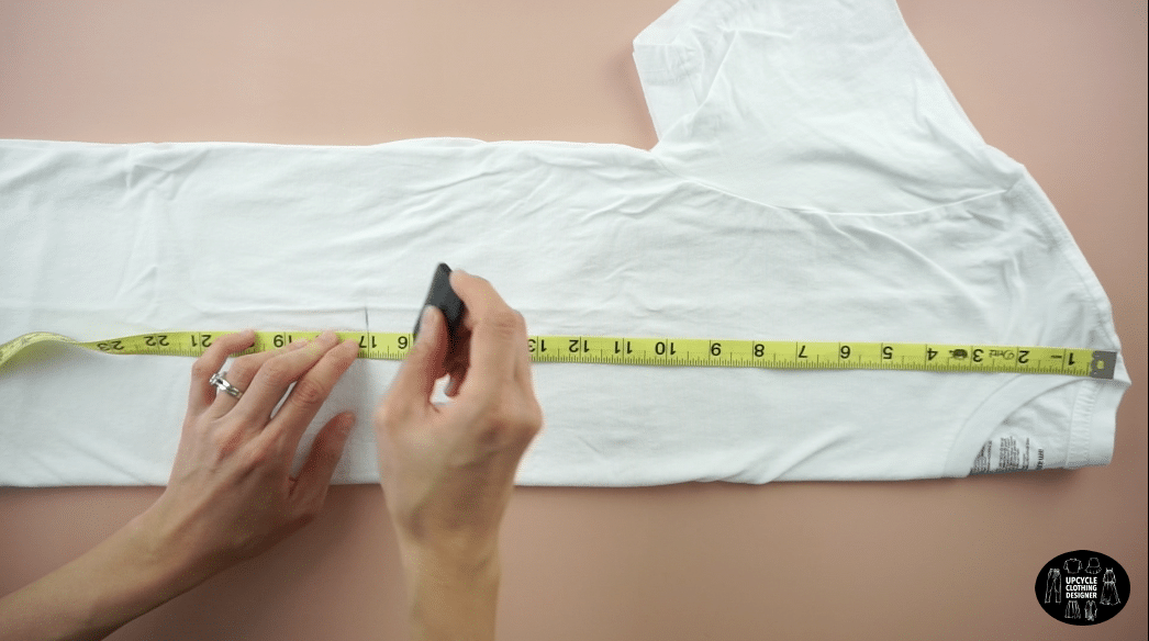 """Fold the t-shirt in half lengthwise. Mark 17"""" down from the high point on the shoulder seam."""