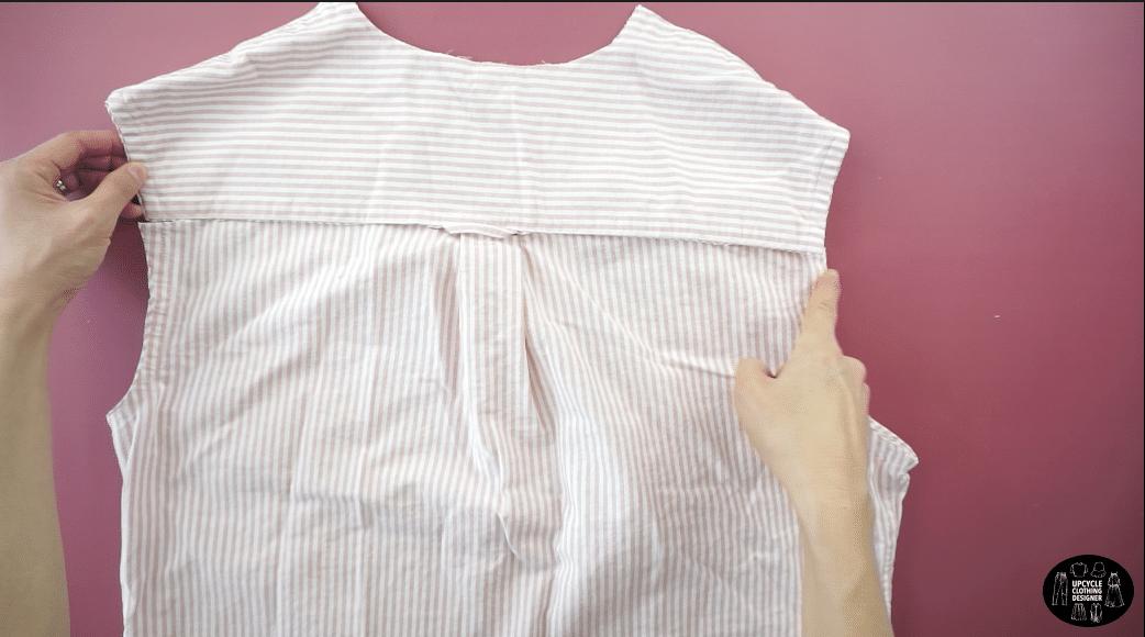 Cut along the back yoke of the original dress shirt.