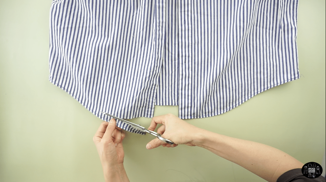 Cut off the bottom hem of the dress shirt
