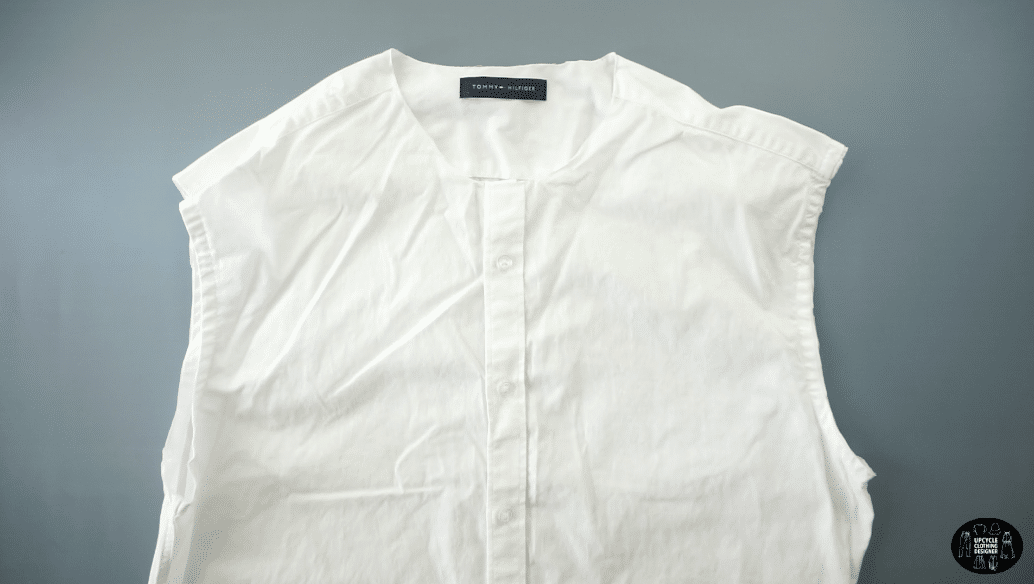 Cut off the neckband, collar and sleeves from the original men's shirt