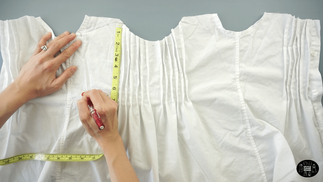 "Draw the shoulder, measure 8"" down and draw a smooth curved line for the new armhole."