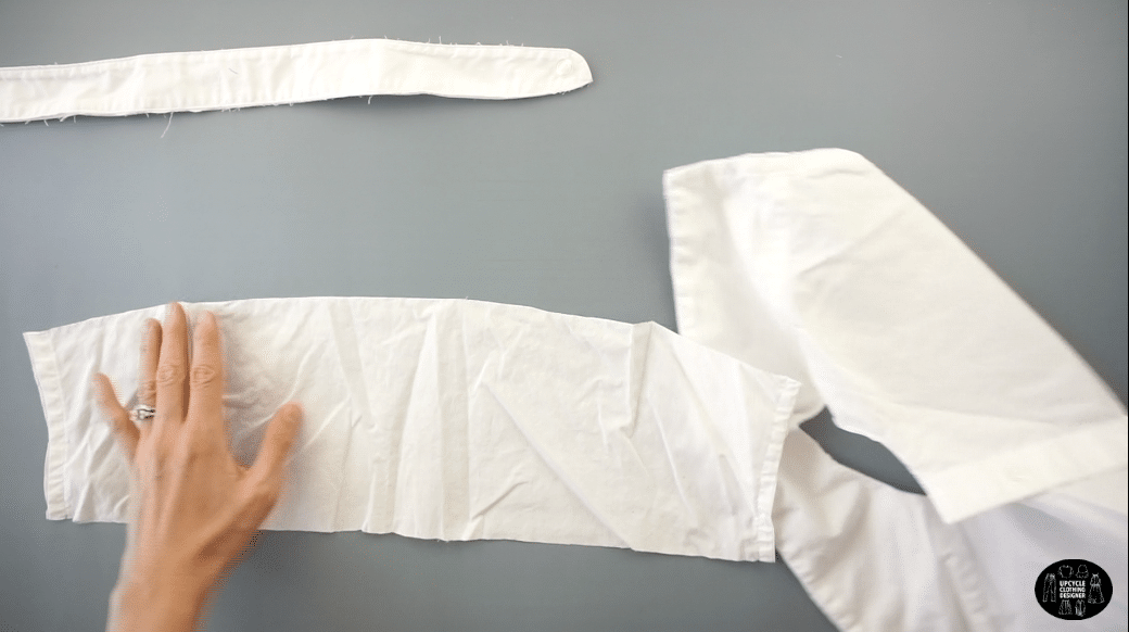 Use the back yoke piece to make the knife pleats for the new neckband.