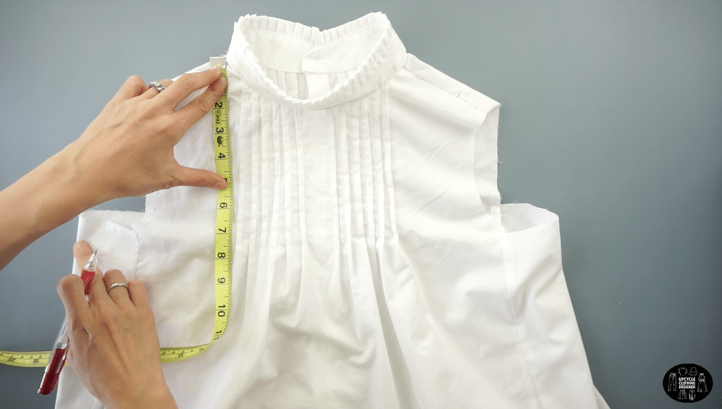"""Mark 8"""" down from the high point on the shoulder seam. Draw a smooth curved lien to make a new armhole opening."""