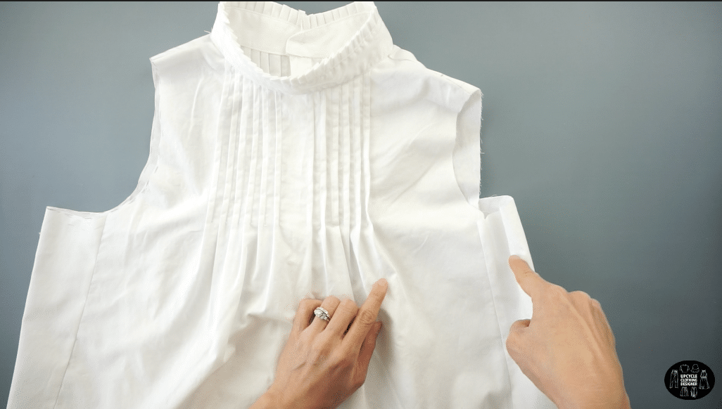 Copy the armhole pattern onto the other side.