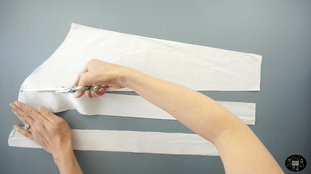"""Cut two separate 2"""" wide straps to make the knife pleats for the armhole."""