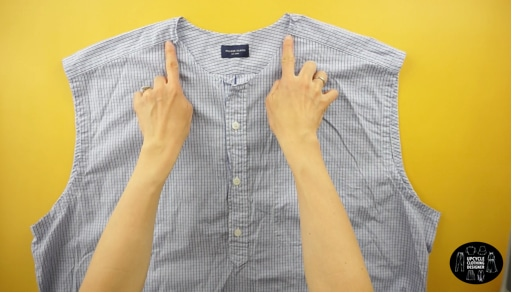 Detach the collar, neckband and sleeves. Cut along the shoulder seams, back yoke and side seams to separate front from the back piece of the original dress shirt.