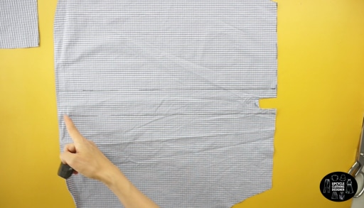 Measure the width of the back of the dress and trim excess fabric from the center line.