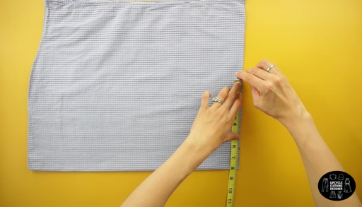 "Measure 8"" from the folded line on the top of the dress bottom."