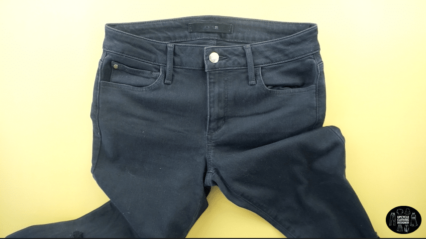 Old jeans with denim fabric in good condition
