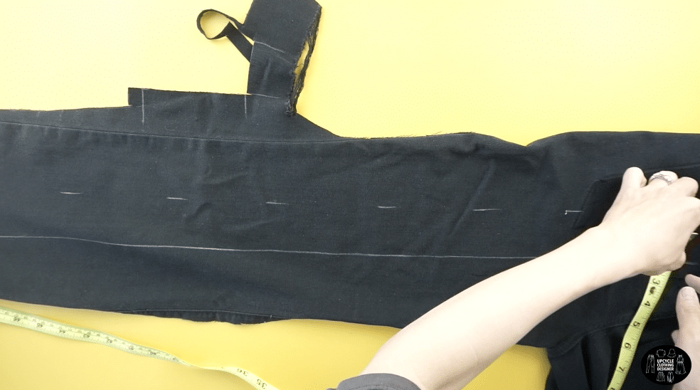 "Remove the pocket from the old jeans and use the leg to make a 2""x30"" shoulder strap"
