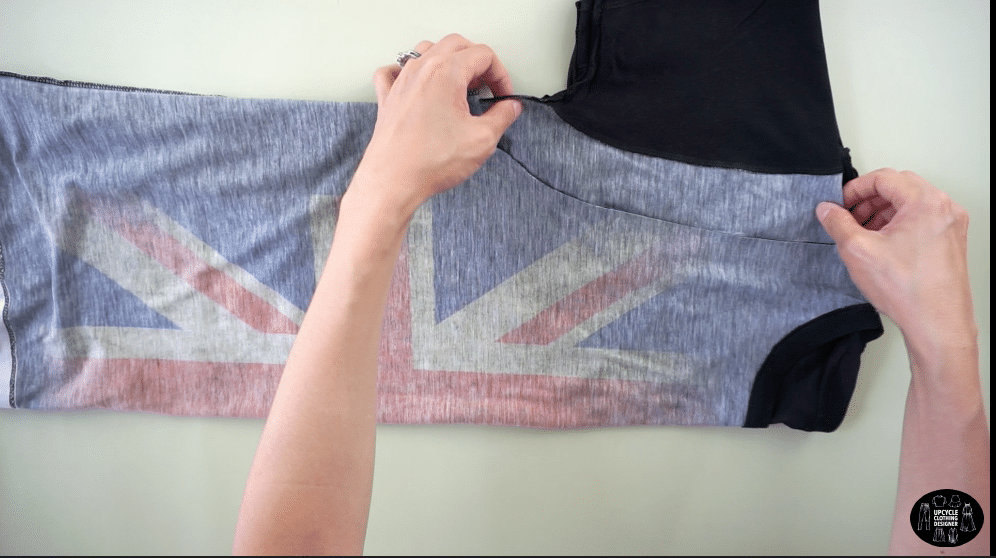 Draw a smooth curved line to make a new armhole for the tank top.