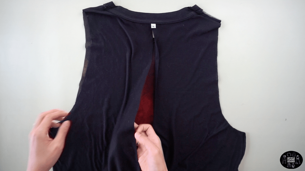 Cut the center back open from hemline and stop at the neckband.