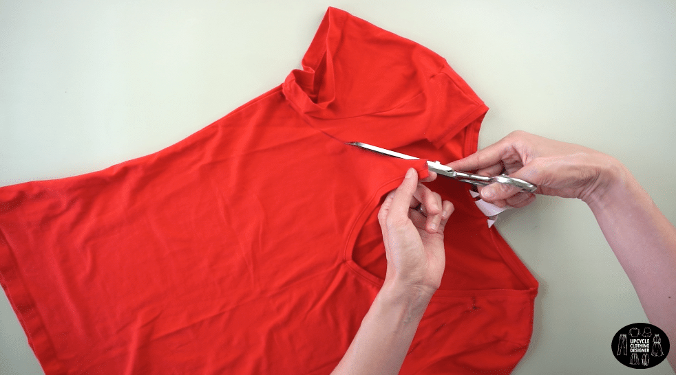 Cut the new armhole opening on the front of the tank top.