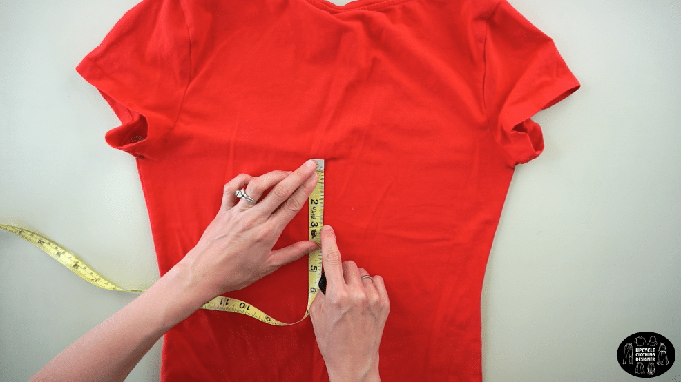 """Locate the center back between both under armhole. Measure 2"""" down the center back to make the cowl back drape."""