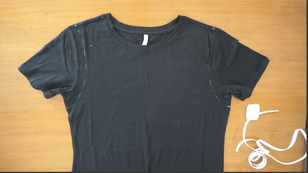 Draw a smooth curved line connecting the points on the shoulder and under the armhole