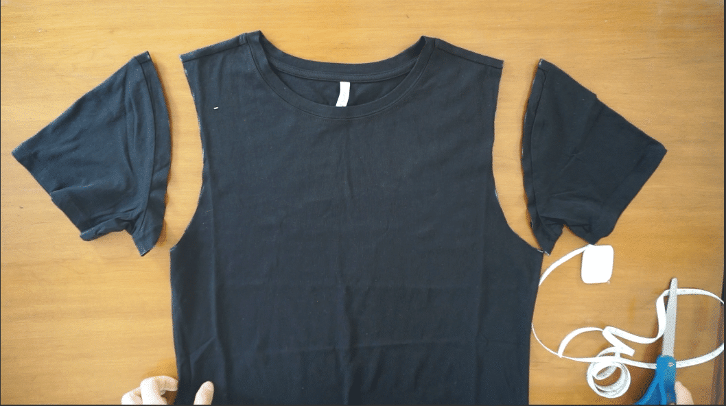 Cut along the line to make a tank top from a t-shirt