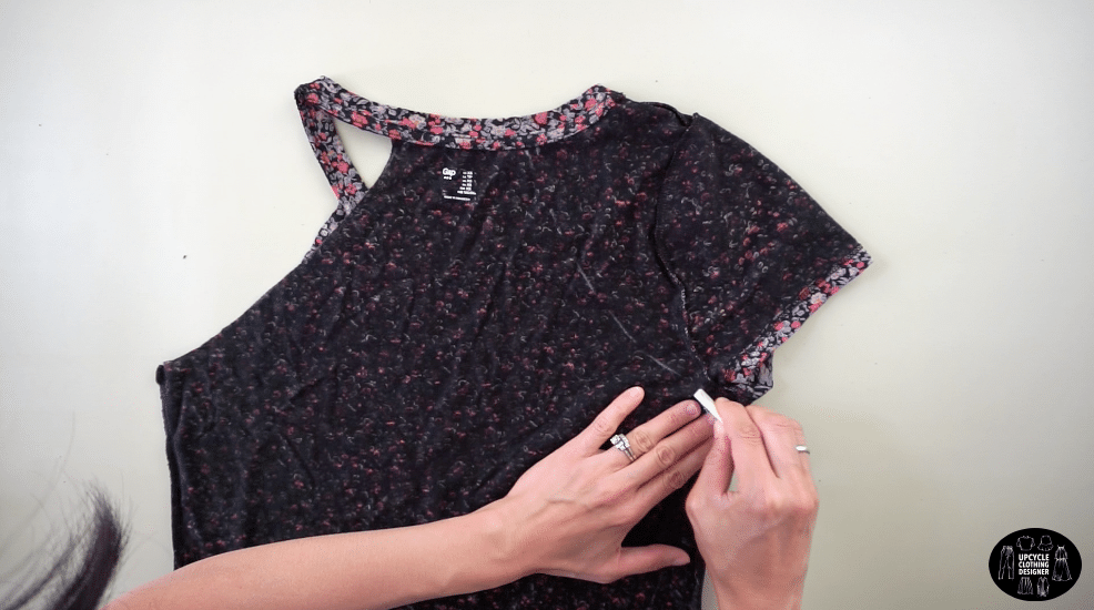 Draw a smooth curved line to the point just underneath the armhole opening.